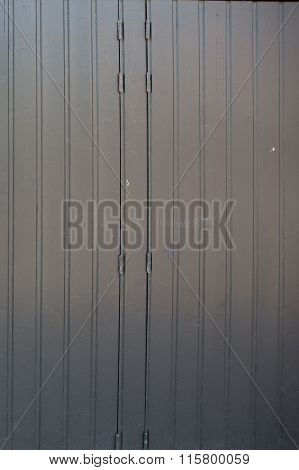 Grey Door With Hinges And Padlock On Wooden Wall