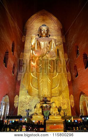 Bagan, Myanmar - March 11, 2015:  Standing Buddha Kassapa At South Facing Part Of The Ananda Temple