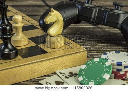 Gamepad, A Chess Board With Figures And Playing Cards