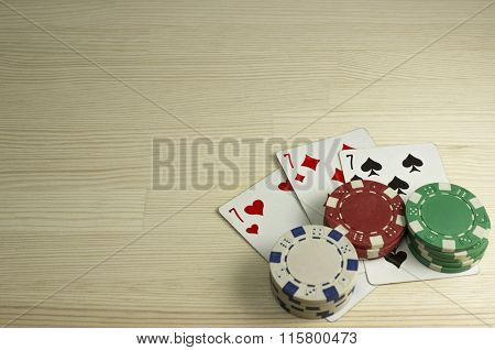 Poker Chips And Playing Cards On The Table. Focus On Cards