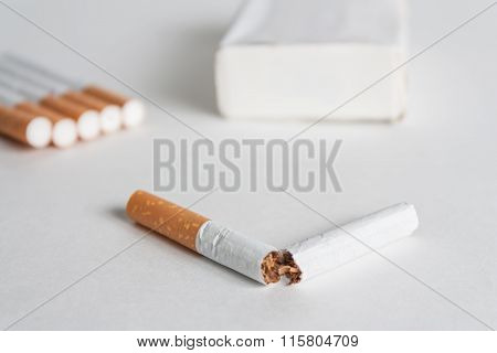 Anti-smoking background with broken cigarette