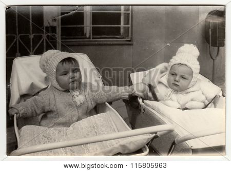 Vintage photo shows babies in prams (baby carrieges).