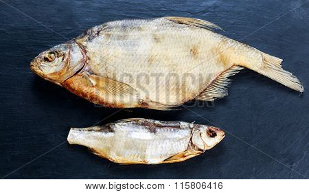 Salted Dry fish vobla on blue stone background