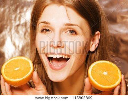 young pretty blond woman with half oranges close up isolated on white bright teenage smiling