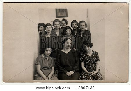 Vintage photo shows a group of girls (classmates) in school hallway with tutor, 1927 in Hodonin.