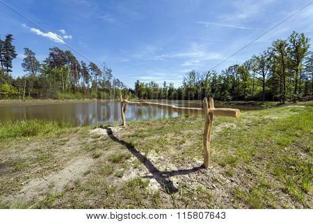 Wooden Barrier On The Lake In Southern Poland