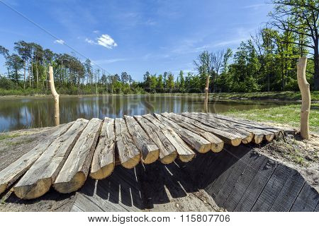 Wooden Footbridge On The Lake