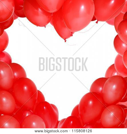 Red balloons form a heart-shaped pattern