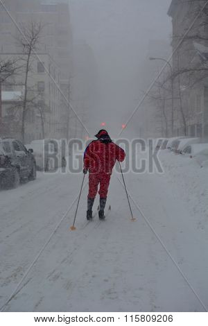 man cross-country skiing on the streets of new york