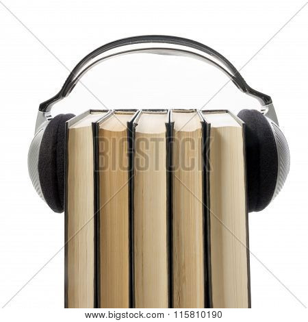 Audio book Stack of hardback books and electronic reader. Electronic library concept. Back to school