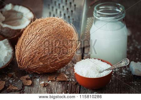 Coconut Milk, Grounded Coconut Flakes, Fresh Coco Nut And Grater On Background.