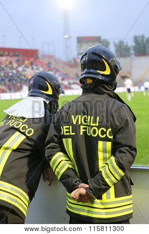 Italian Firefighters In The Big Hardhat During The Sports Event