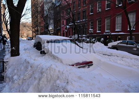 Cars covered in snow, New York following snow storm