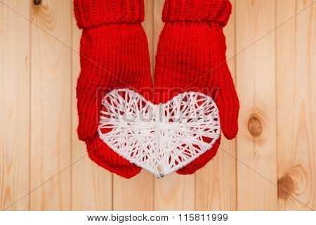 Valentines Day Background. Girl Holds Knitted Heart In Red Mittens