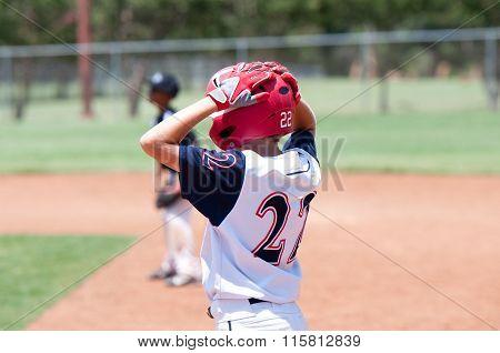 Young American Baseball Boy On Base