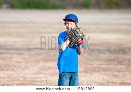 Young Boy Playing Backyard Baseball