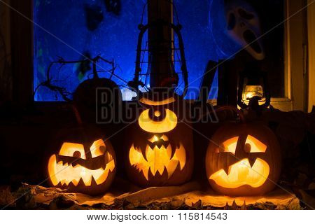 Photo Composition From Three Pumpkins On Halloween. Embittered, Cyclop And Frightened Pumpkins Again