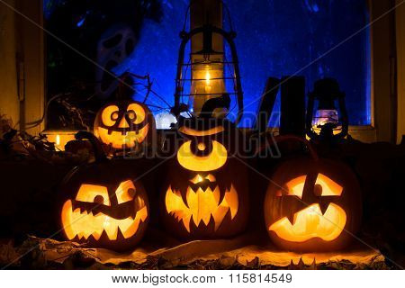 Photo Composition From Three Pumpkins On Halloween