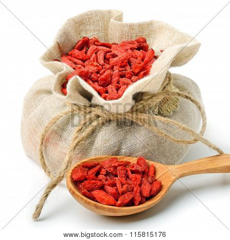 Goji Berries In The Sack Bag With Wooden Spoon Isolated
