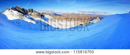 The Ski Slope And Skiers At Presena Glacier Ski Area, Italy