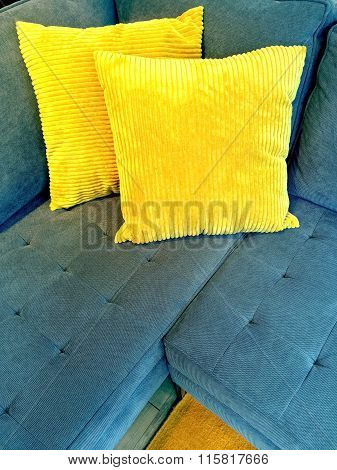 Blue Sofa With Bright Yellow Cushions