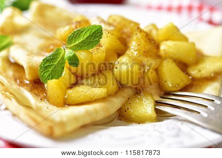 Thin Pancakes With Caramelized Apples And Cinnamon.