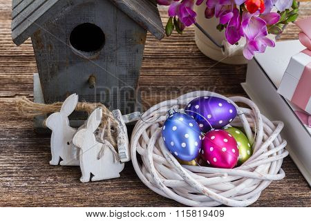 Spring rabbits with easter eggs