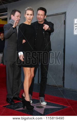 LOS ANGELES - JAN 25:  Claire Holt, John McNamara, David Duchovny at the David Duchovny Hollywood Walk of Fame Star Ceremony at the Fox Theater on January 25, 2016 in Los Angeles, CA