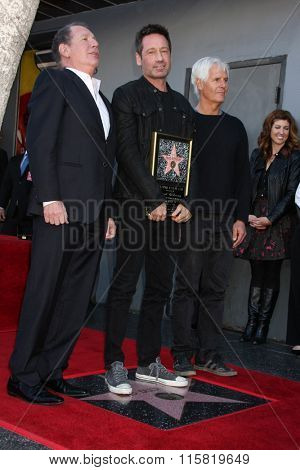 LOS ANGELES - JAN 25:  Garry Shandling, David Duchovny, Chris Carter at the David Duchovny Hollywood Walk of Fame Star Ceremony at the Fox Theater on January 25, 2016 in Los Angeles, CA