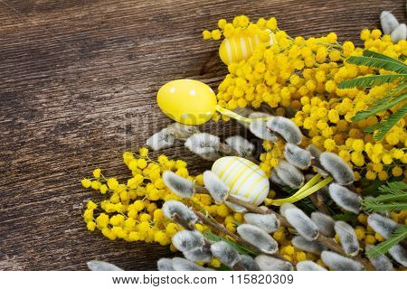 French mimosa and catkins with easter eggs