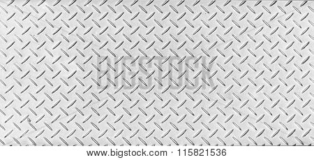 Texture of a tough metal diamond pattern plate.
