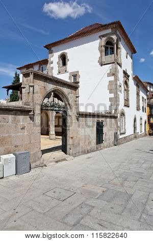 Braga, Portugal - July 27, 2015: The Coimbras House entrance. Historical medieval architecture in Manuelino style, the Portuguese Gothic.