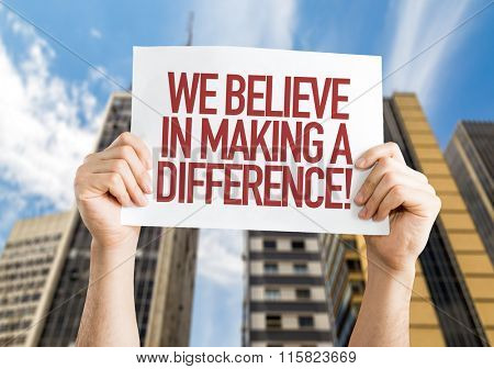 We Believe in Making a Difference placard with urban background
