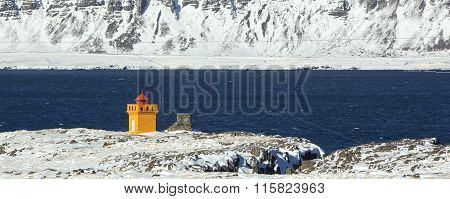 Wide Shot Panorama Of An Orange Lighthouse, Iceland
