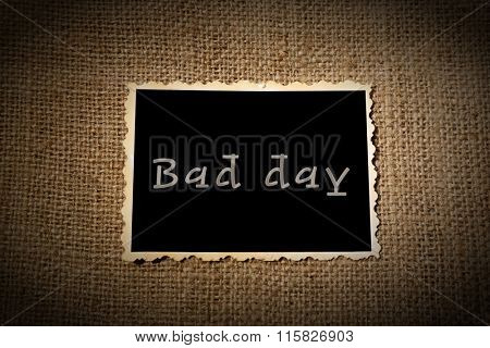 Photo paper with text Bad day on sackcloth background
