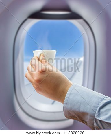 Drinking A Coffee At The Flight