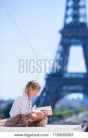 Adorable little girl in Paris background the Eiffel tower