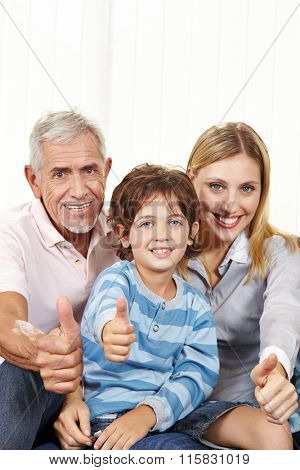Happy family in living room holding thumbs up for congratulations