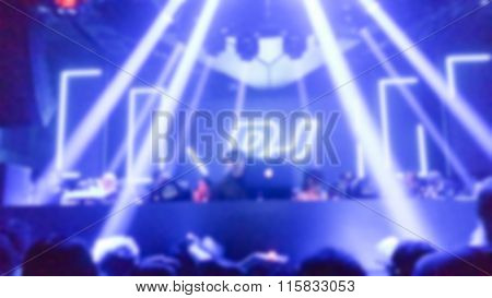 Dj Playing And People Dancing At The Concert, Laser Show And Music With The Word Dj Behind