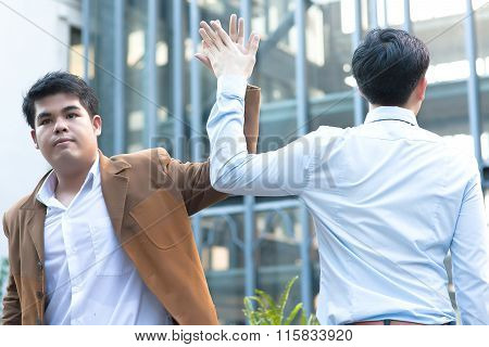 Young Diverse Asian Business Men Giving High Five