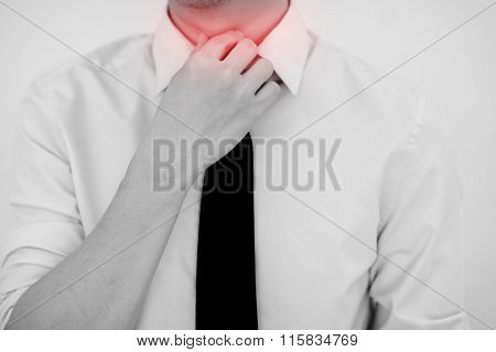 Man Having Painful Sore Throat. Touching Neck. Isolated White Background
