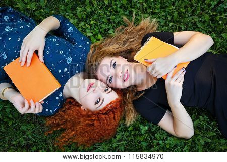 Best Friends Are Female Students On Lawn.