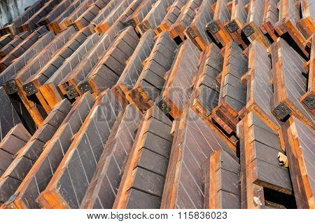 Stack of construction materials - wooden boards, planks