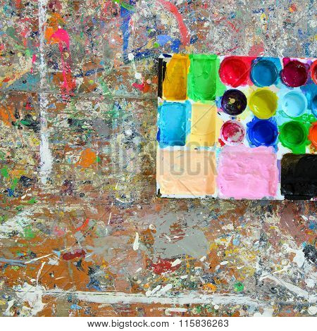 Colorful Palette And Splash Acrylic Color On Wood Table.