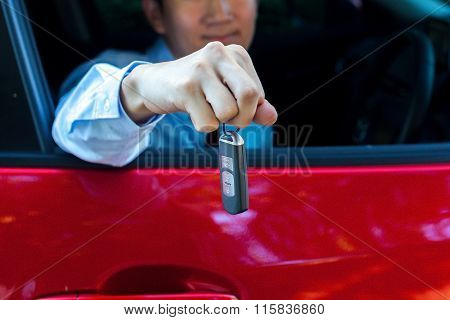 Young Asian Businessman Giving Out A Car Key Inside A Car