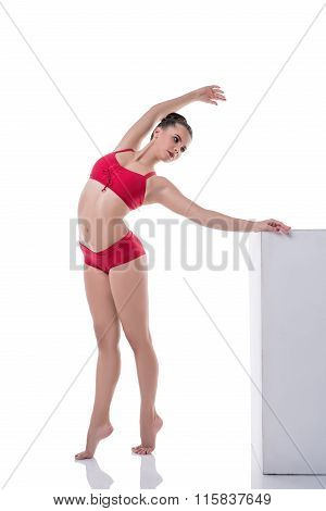 Graceful girl training while standing on tiptoe