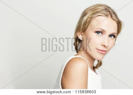 Elegant blonde young woman