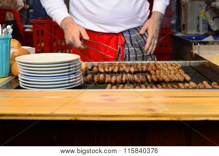 Man Grill Hot Dogs In The Shop In Germany
