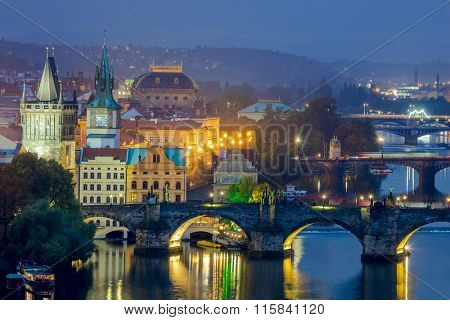 Famous View of Prague, bridges and landmarks at evening time with illumination, travel in Europe