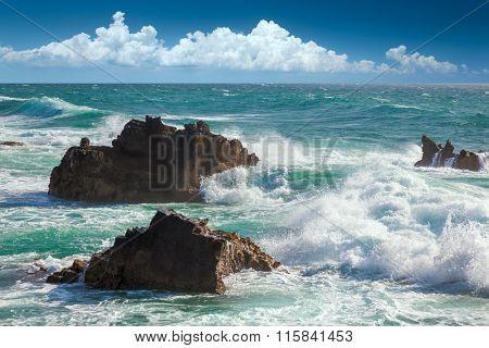 Beautiful Turquoise Ocean Waves, rocks coastline and blue sky - resort landscape